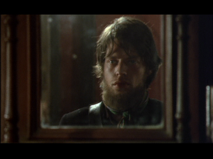 When Ned Kelly looks in the mirror, what does he see? Mick Jagger's beard.
