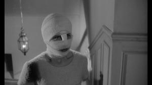 A bandaged victim.